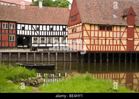 Half Timbered houses of old Aarhus. A small row boat floats quietly in the water in front of rows of traditional - Stock Photo