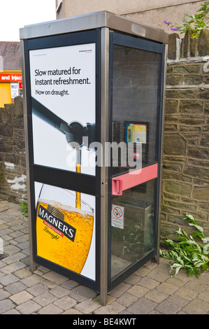 Billboard for Magners Cider on BT telephone box in UK - Stock Photo