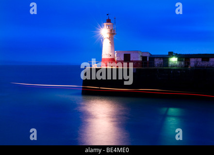 The Lighthouse at the end of the Newlyn Pier at dawn, long exposure, Newlyn, Cornwall, UK - Stock Photo