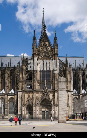 Cologne Cathedral, High Cathedral of St. Peter and Maria, portal of the southern transept, tourists walking in front, - Stock Photo