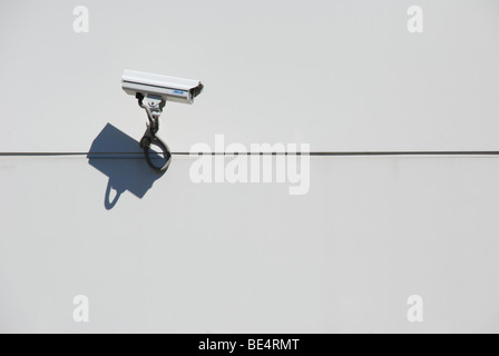 Security Camera on plain wall with shadow - Stock Photo