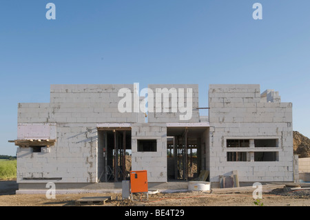 Shell construction, construction site, residential building with support pillars for the first-floor floor slab - Stock Photo