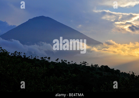 Sunset with the volcano Gunung Agung in Amed, Bali, Indonesia, Southeast Asia - Stock Photo