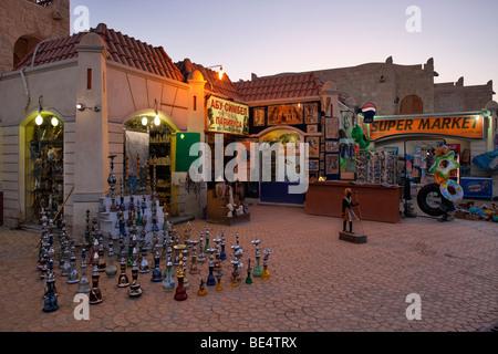 Souvenir shop, water pipes, shishas, illuminated, evening, Yussuf Afifi road, Hurghada, Egypt, Red Sea, Africa - Stock Photo