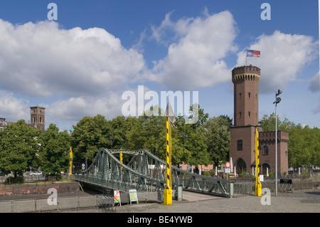 Malakoff swing bridge at Rheinauhafen in front of Cologne Chocolate Museum, steel-truss pedestrian bridge, industrial - Stock Photo