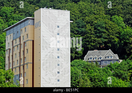 Pre-fabricated concrete building of the GDR, in the back a villa on the Domberg mountain, Suhl, Thuringia, Germany, - Stock Photo
