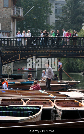 Tourists watching tourists in their punts on the river Cam, Cambridge. - Stock Photo