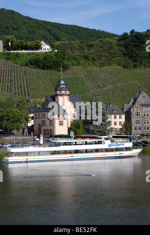An excursion boat on the Mosel river passing Bernkastel-Kues, Mosel river, Rhineland-Palatinate, Germany, Europe - Stock Photo