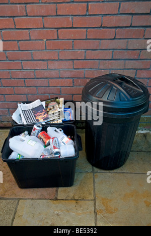 Domestic rubbish collection,  showing separated waste for re -cycling , Paper bin  Plastic Bin  and domestic household - Stock Photo
