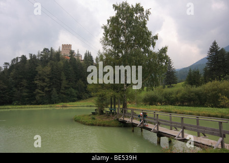 A small rocky castle with a pond at Losenheim ski resort in Austrian Alps. - Stock Photo