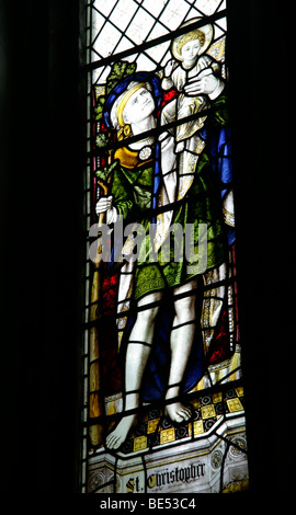 Stained Glass Window Depicting St Christopher carrying Jesus across the river, Hough on the Hill, Lincolnshire - Stock Photo