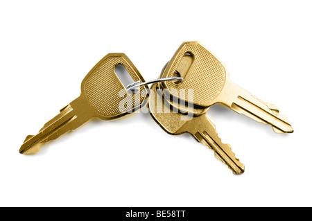 Bunch of keys isolated on white background - Stock Photo