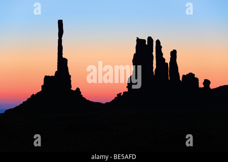 First light at Yei-bi-Chai rocks in Monument Valley - Stock Photo