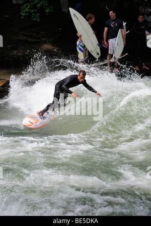 Surfer on the Eisbach stream, English Garden in Munich, Upper Bavaria, Bavaria, Germany, Europe - Stock Photo