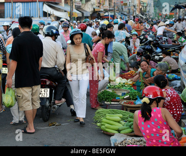 Many people crowd on the road at a street market, Vinh Longh, Mekong Delta, Vietnam, Asia
