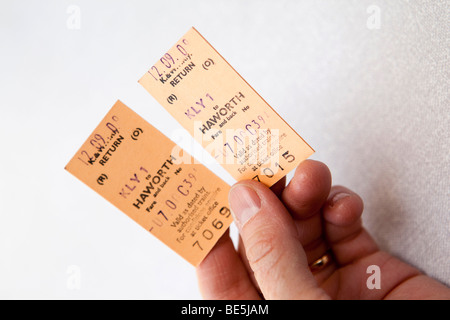 UK, England, Yorkshire, Keighley and Worth Valley Steam Railway, hand holding two return tickets - Stock Photo