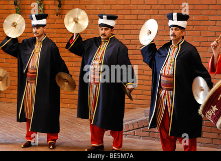 Costumed musicians playing cymbals, historic chapel Janitscharen Military, Mehter Chapel, demonstration in the military - Stock Photo