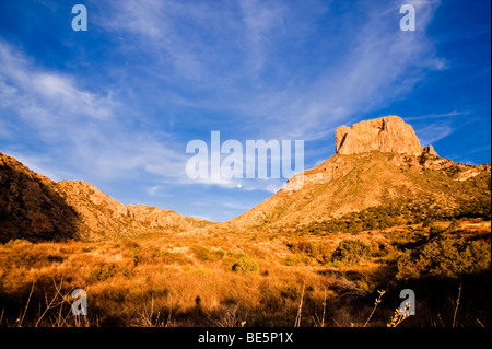 Moon rise over Casa Grande, Big Bend National Park - Stock Photo