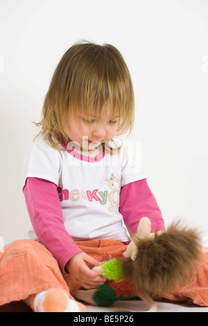 Toddler girl with toy - Stock Photo