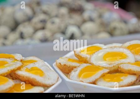 Quail eggs, cookshop in Thailand, Asia - Stock Photo