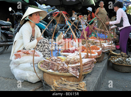 Woman sells dried fish, street market, Vinh Longh, Mekong Delta, Vietnam, Asia - Stock Photo