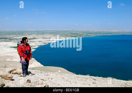 Hiker on Mt Jebel Arruda, Assad reservoir of Euphrat River in the back, Syria, Asia - Stock Photo