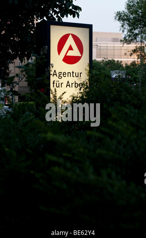 Agency for employment, illuminated sign - Stock Photo