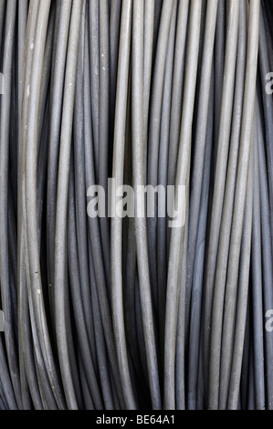 Steel rods, by the meter, on a cable reel - Stock Photo