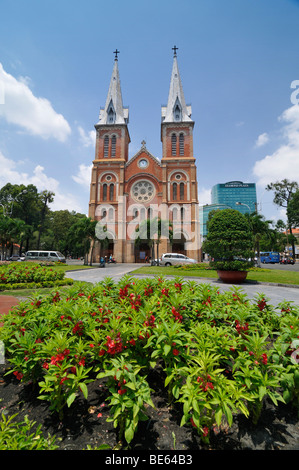 Catholic Cathedral of Notre Dame, Nha Tho Duc Ba - Church of Our Lady, in the back the Diamond Plaza Shopping Center, - Stock Photo