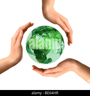 Conceptual recycling symbol made from hands over Earth globe - Stock Photo