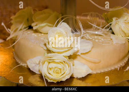 Close up photograph of a rose decorations on a wedding cake - Stock Photo
