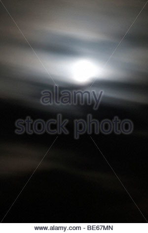 full moon at night with moving clouds - Stock Photo