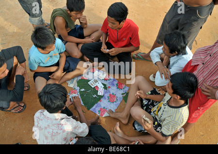 Teenagers playing cards in the slums of Siem Reap, Cambodia, Asia - Stock Photo