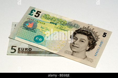 Euro and United Kingdom Pound Bank Notes. - Stock Photo