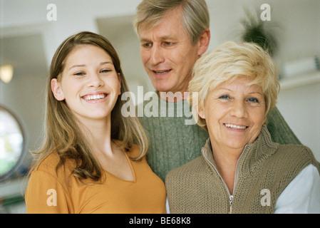 Teenage girl with grandparents - Stock Photo