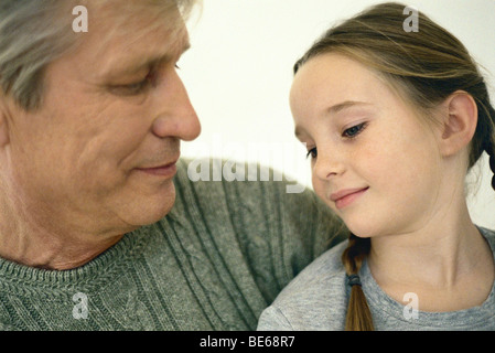 Little girl with grandfather, portrait - Stock Photo