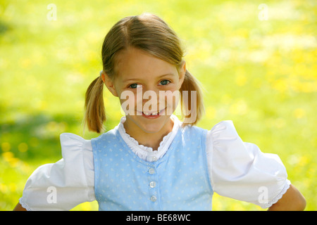 Young girl with missing tooth - Stock Photo