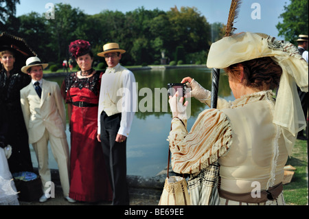 Paris, France - Group People Posing, French, Chateau de Breteuil, Woman in Costume Dress, Rear, over shoulder Photographer - Stock Photo