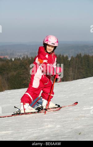 Young girl on skis, Beuerberg, Bavaria, Germany, Europe - Stock Photo