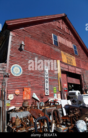 Big red barn, items for sale, junk store, Searsport, Maine - Stock Photo