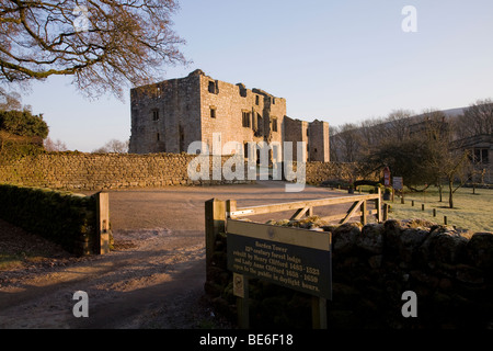 Barden Tower (sunlight on beautiful historic ancient ruin & information sign at entrance gate) - Bolton Abbey Estate, Yorkshire Dales, England UK.