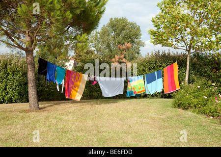 Colourful washing hanging on a washing line - Stock Photo