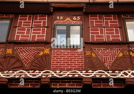 Old colorfully decorated half-timbered facade, 1565, detail, Lueneburg, Lower Saxony, Germany, Europe - Stock Photo