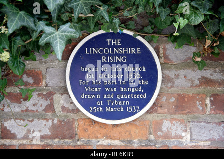 Blue Plaque Commemorating the Lincolnshire Rising outside the Church at Market Rasen, Lincolnshire - Stock Photo
