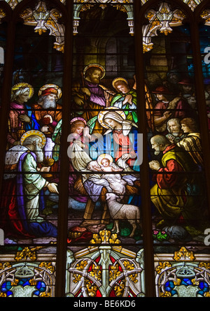 A depiction of the Nativity of Jesus Christ in stained glass at St. Patrick's Roman Catholic Church in Bisbee, Arizona. - Stock Photo