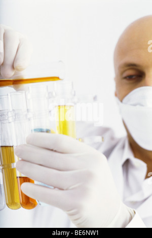 Laboratory technician transferring liquid to test tube - Stock Photo