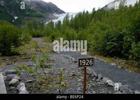 Exit glacier, Seward, Alaska.  Revealing glacial retreat, a sign shows where the glacier extended to in 1926 - Stock Photo
