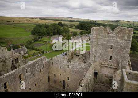 View from high ramparts over castle ruins, village houses & beautiful scenic countryside - Bolton Castle, Wensleydale, - Stock Photo