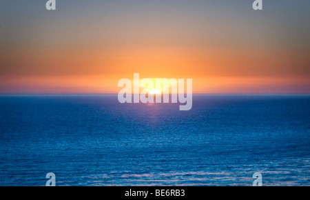 Sunset over the Pacific Ocean off the coast of San Pedro, California. - Stock Photo