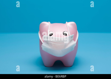Swine flu concept, toy pig wearing flu mask - Stock Photo